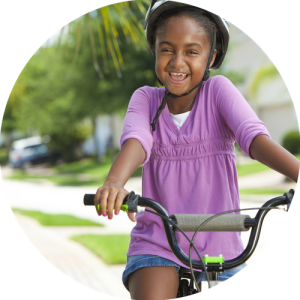 Girl pedalling cycling tuition bring a friend