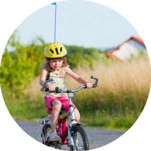 girl pedalling cycling tuition